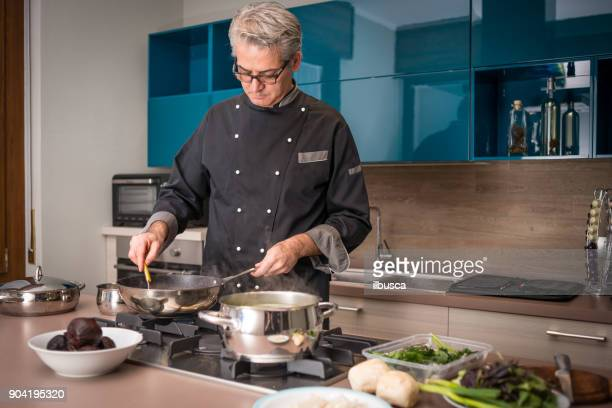 Professional chef preparing meal in private house: Stir tomato soup