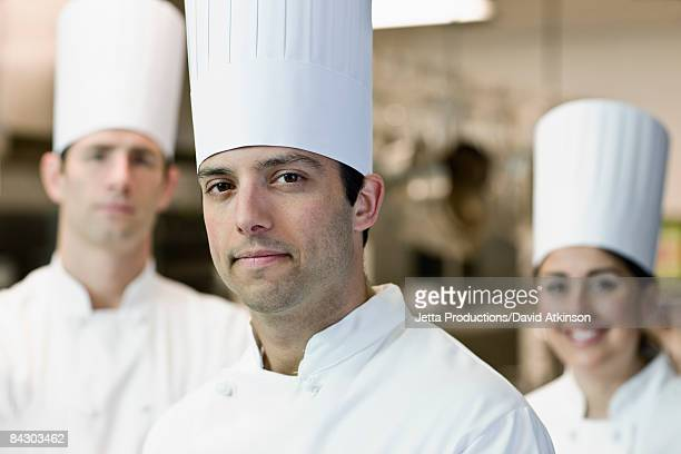 Professional chefs in uniforms
