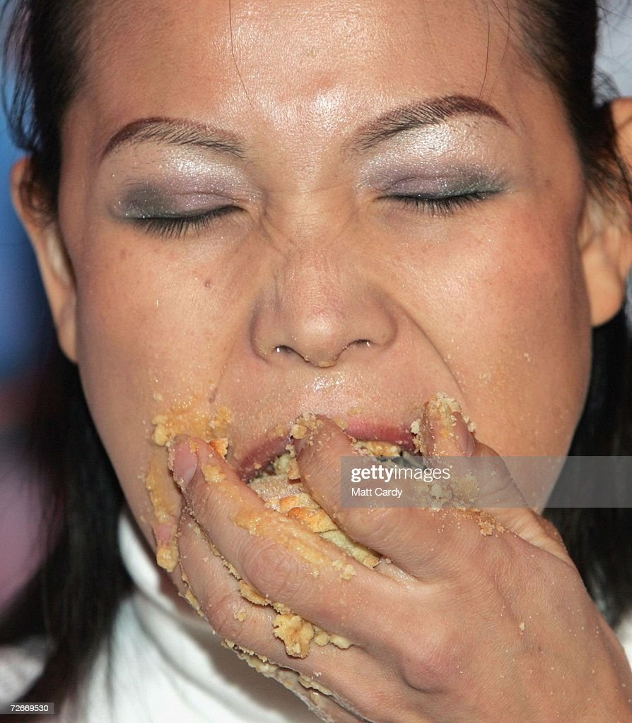 Professional competitive eater Sonya Thomas, aka 'The Black Widow', competes during the Wookey Hole Big Eat, Mince Pie Eating Contest at the Wookey Hole Show Caves on November 29 2006 in Wookey Hole, near Wells, England. 12 handpicked competitors, professionals and members of the public alike, will attempt to eat as many mince pies as possible in the space of 10 minutes.