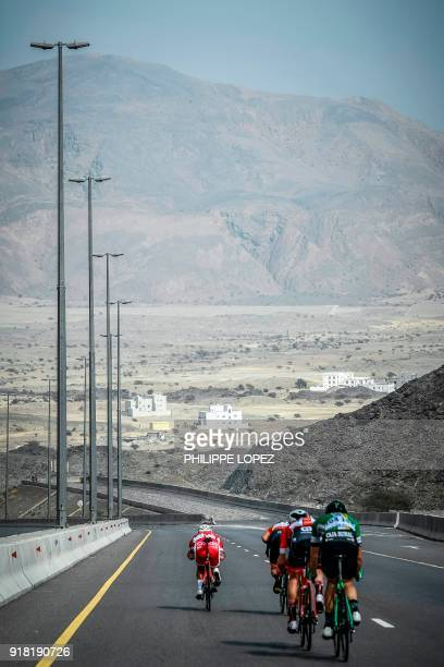 UCI Professional Continental team Cofidis' French rider Loic Cheteout rides down a hill near the Omani capital Muscat during the second stage of the...