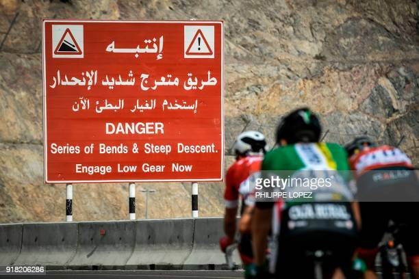 UCI Professional Continental team Cofidis' French rider Loic Cheteout leads the pack as they cycle near the Omani capital Muscat during the second...