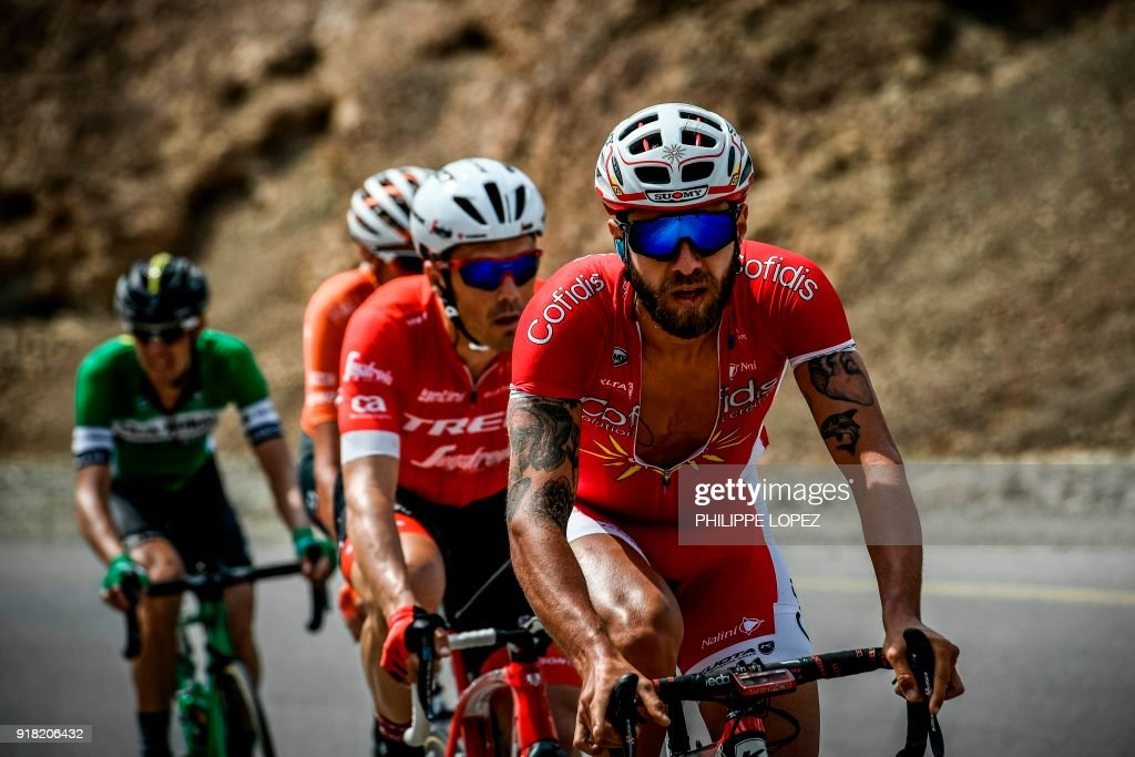 UCI Professional Continental team Cofidis' French rider Loic Cheteout (front) leads the pack as they cycle near the Omani capital Muscat during the second stage of the 2018 cycling Tour of Oman, from Sultan Qaboos University to Al-Bustan, west of the capital Muscat on February 14, 2018. / AFP PHOTO / Philippe LOPEZ