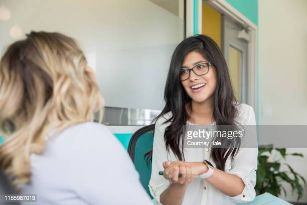 professional counselor giving advice to client or patient during a session - mental health professional stock pictures, royalty-free photos & images