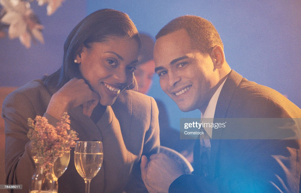 Professional couple sitting together : Stockfoto