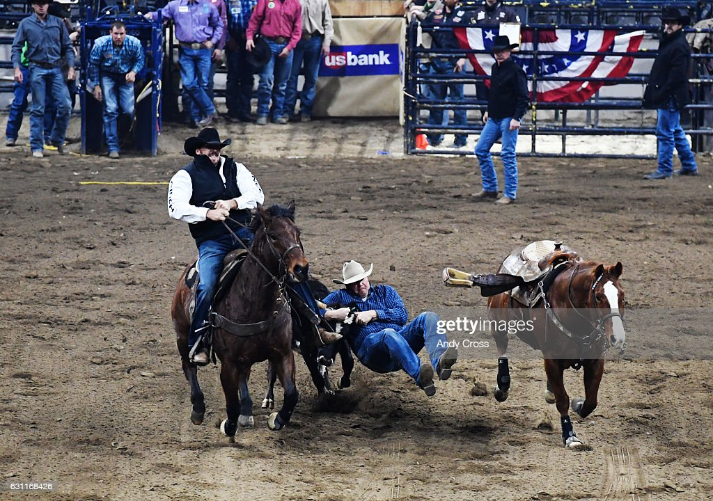 Professional cowboy Cody Woodward during the steer wrestling competition at the Colorado vs The World Rodeo on the first day of the National Western Stock Show January 07, 2017.
