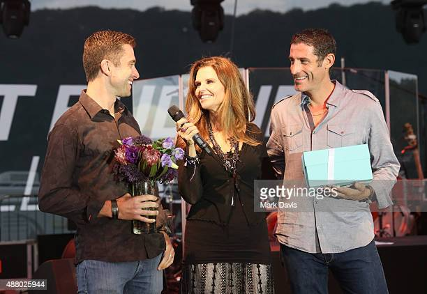Professional cyclist Christian Vande Velde Honorary CoChair Maria Shriver and professional cyclist George Hincapie speak onstage at the Hearst Ranch...