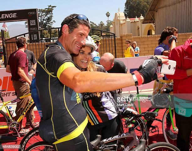 Professional cyclist George Hincapie and Best Buddies Challenge Event CoChair Maria Shriver take a selfie at the finish line of the Best Buddies...