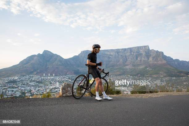 Professional cyclist taking a coffee break