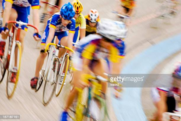Professional cyclists racing in peloton formation around a velodrome