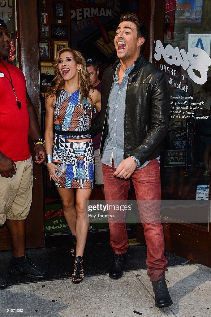 Professional dancer Allison Holker (L) and actor Jonathan Bennett leave Planet Hollywood Times Square on September 4, 2014 in New York City.