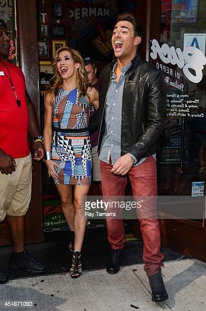 Professional dancer Allison Holker and actor Jonathan Bennett leave Planet Hollywood Times Square on September 4 2014 in New York City