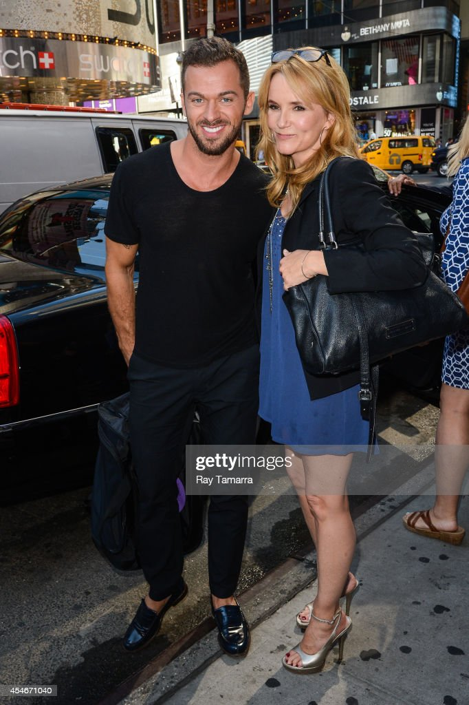 Professional dancer Artem Chigvintsev (L) and actress Lea Thompson leave Planet Hollywood Times Square on September 4, 2014 in New York City.
