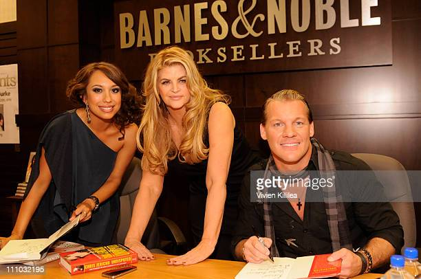 Professional dancer Cheryl Burke and wrestler Chris Jericho sign copies of their books for actress Kirstie Alley at Cheryl Burke And Chris Jericho...