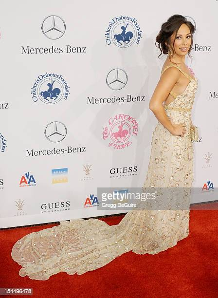 Professional dancer Cheryl Burke arrives at the 26th Anniversary Carousel Of Hope Ball presented by MercedesBenz at The Beverly Hilton Hotel on...