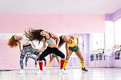 Professional dancer class dancing in dancing studio