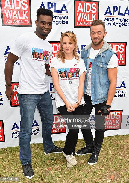 Professional dancer Keo Motsepe actress Lea Thompson and professional dancer Artem Chigvintsev attend the 30th Annual AIDS Walk Los Angeles on...