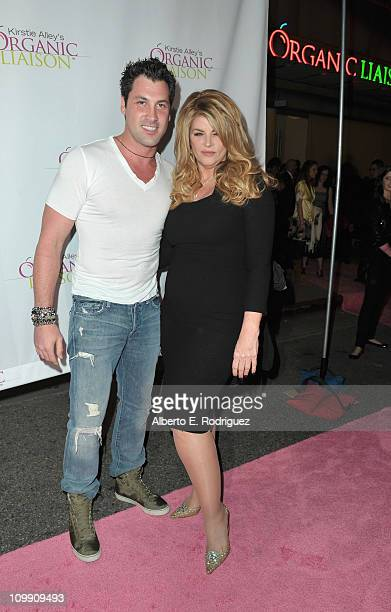 Professional dancer Maksim Chmerkovskiy and actress Kirstie Alley arrive to the opening of Kirstie Alley's Organic Liaison Store on March 9 2011 in...