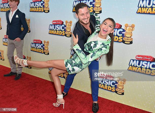 Professional dancer Val Chmerkovskiy and actress Zendaya Coleman arrive to the 2013 Radio Disney Music Awards at Nokia Theatre L.A. Live on April 27,...