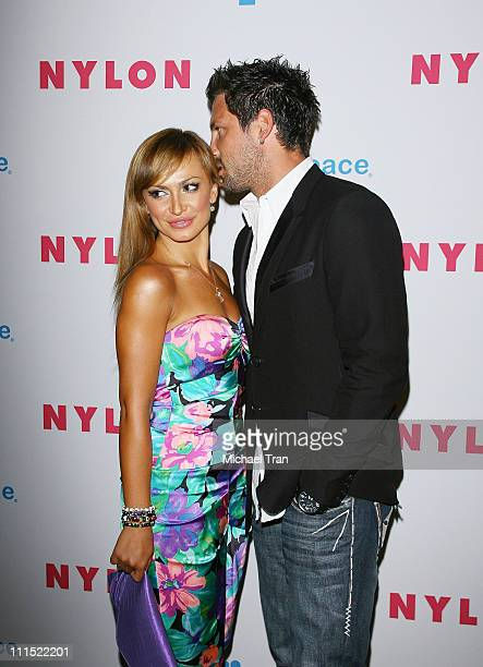 Professional dancers Maksim Chmerkovskiy and Karina Smirnoff arrive to the NYLON Magazine and MYSPACE Young Hollywood party held at The Roosevelt...