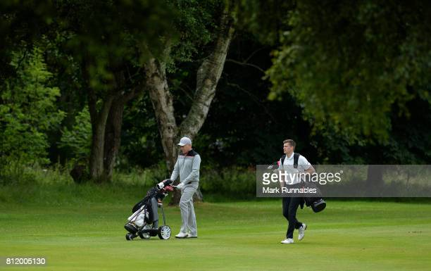 Professional Dean Vannet and Darren Reid of Banchory Golf Club walk together to the 10th hole during the Lombard Trophy Scottish Qualifier at Crieff...