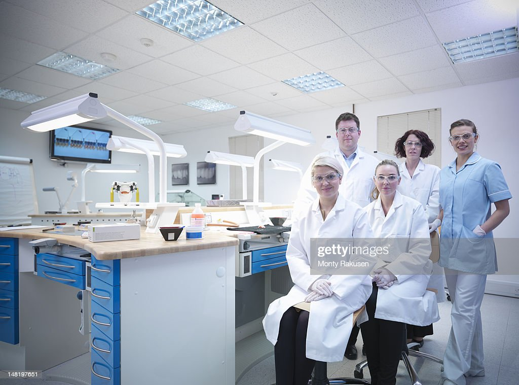 Professional dentists and apprentices in dental laboratory : Stock Photo