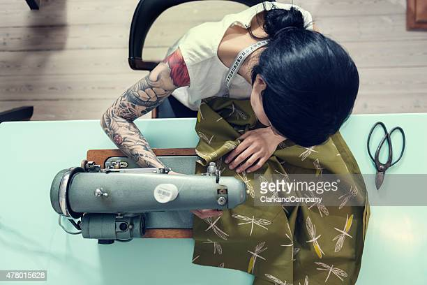 professional dressmaker at work - top garment stock photos and pictures