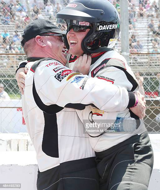 Professional driver Al Unser Jr and actor Brett Davern celebrate after winning the 37th Annual Toyota Pro/Celebrity Race on April 12 2014 in Long...