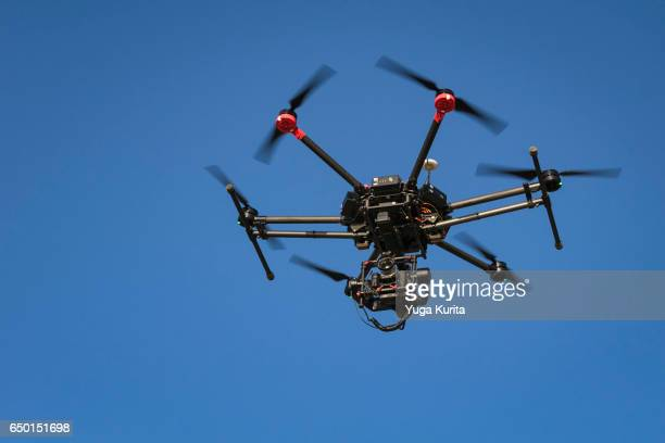 Professional Drone Hovering against the Blue Sky