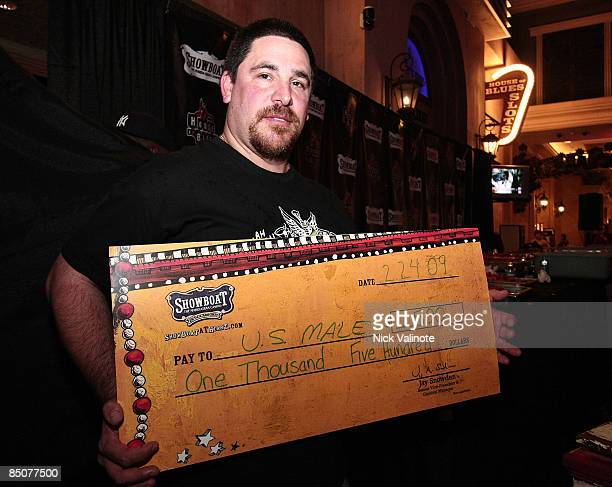 Professional eater Dave US Male Goldstein shows his winnings at the Showboat Mudbug Eating Championship at the House of Blues restaurant on February...