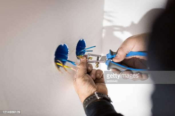 professional electrician job - electricity stock pictures, royalty-free photos & images