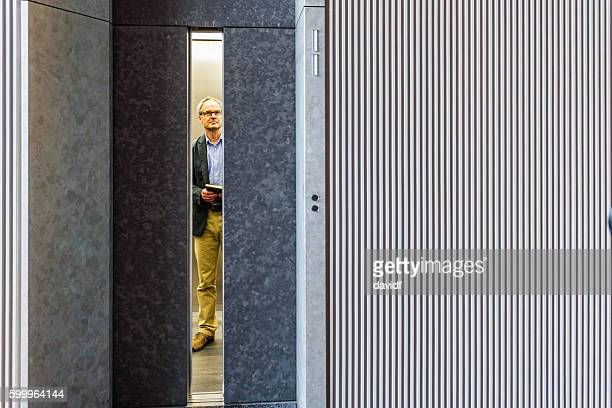 Professional English Businessman Waiting for Modern Corporate Office Building Elevator