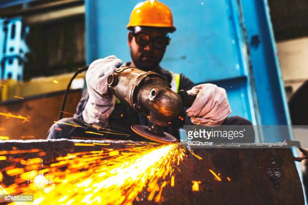 professional factory employee grinding metals to a polishes finish - industry stock pictures, royalty-free photos & images