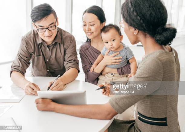professional family consutation - insurance agent stock pictures, royalty-free photos & images