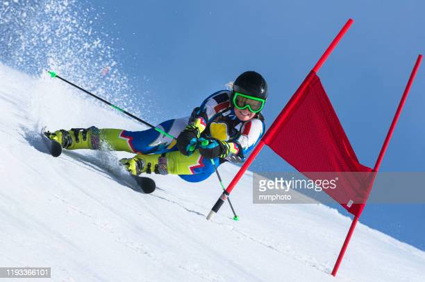 professional female alpine skier at giant slalom race - ski racing stock pictures, royalty-free photos & images