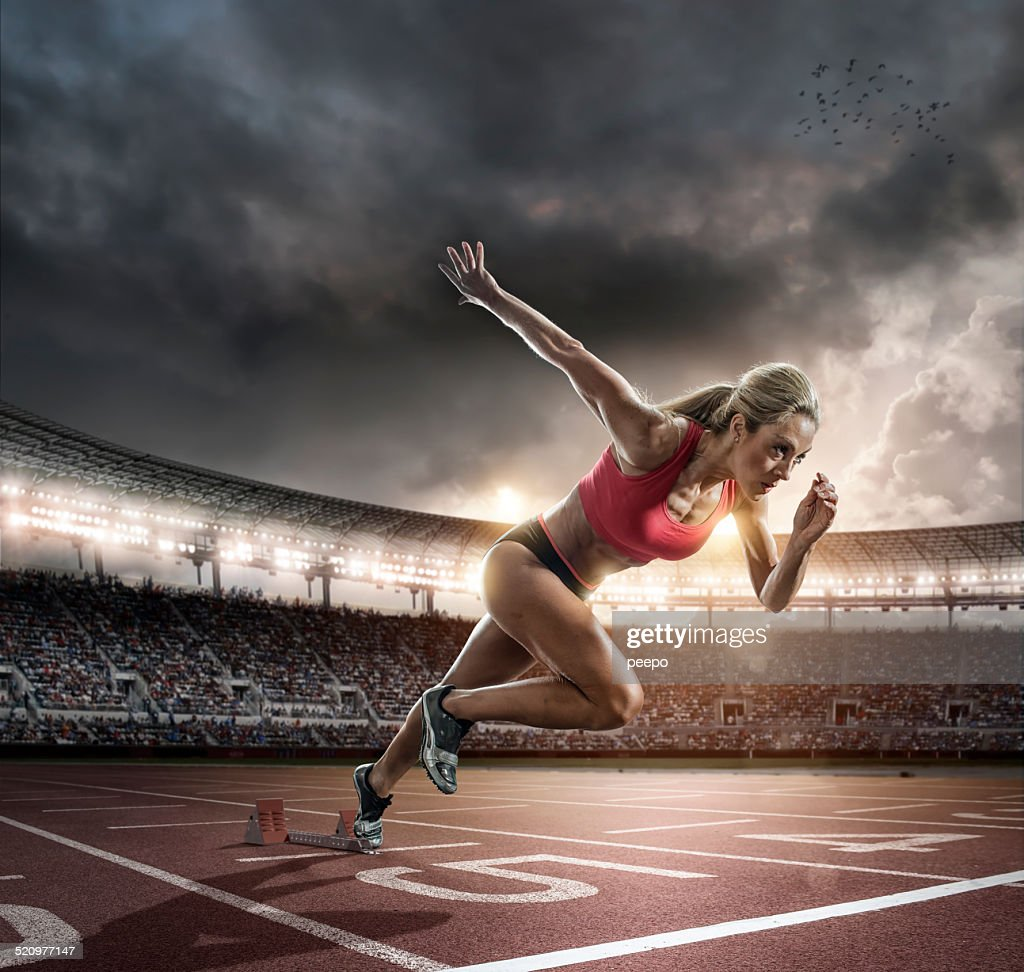 Professional Female Athlete Sprinting Off Blocks : Stock Photo