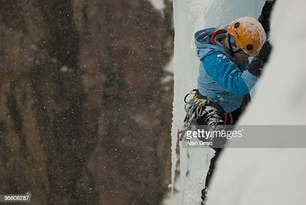 A professional female climber ice climbing at Ouray Ice Park in Ouray, Colorado.