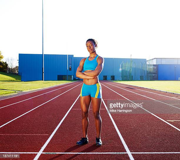 professional female hurdler standing on race track - sportsperson stock pictures, royalty-free photos & images