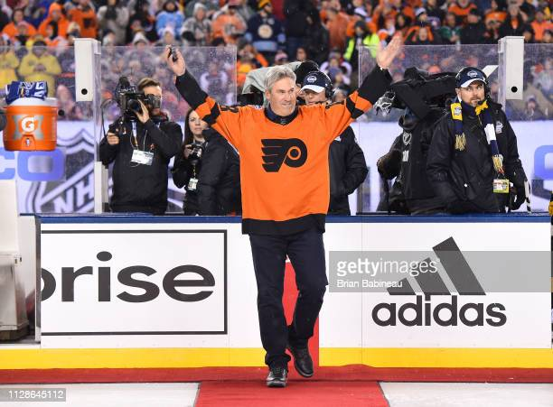 Professional football coach Doug Pederson acknowledges the fans prior to dropping the puck for the ceremonial opening faceoff prior to the 2019 Coors...