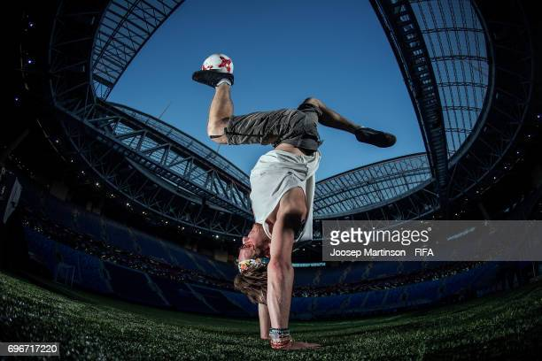 Professional football freestyler and circus artist Vladislav Kostuchenko poses for a photo prior to performing in the opening ceremony of FIFA...