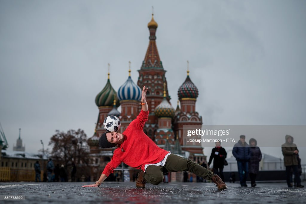 Professional football freestyler, circus artist and 2018 FIFA World Cup Russia Draw performer Vladislav Kostuchenko poses with the official adidas match ball Telstar18 in front of St. Basil's Cathedral on the Red Square on November 30, 2017 in Moscow, Russia.