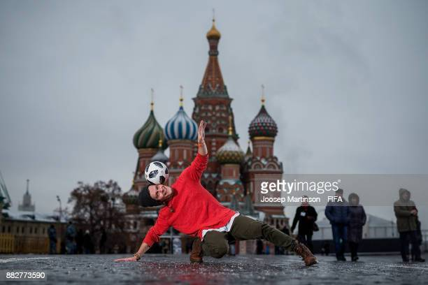 Professional football freestyler circus artist and 2018 FIFA World Cup Russia Draw performer Vladislav Kostuchenko poses with the official adidas...