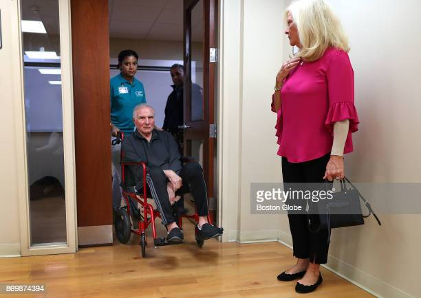 Professional Football Hall of Fame linebacker Nick Buoniconti arrives at the Boston University School of Medicine conference room with the help of an...