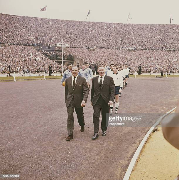 Professional football managers Harry Potts of Burnley FC and Bill Nicholson of Tottenham Hotspur lead out their respective teams before the start of...