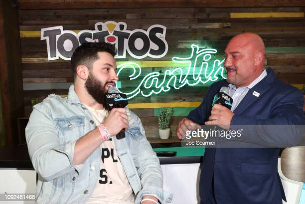 Professional football player Baker Mayfield and host Jay Glazer speak at The Tostitos Cantina at Super Bowl LIVE in Atlanta Georgia