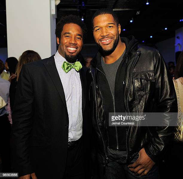 Professional Football Player Dhani Jones and former NFL playerMichael Strahan attend the exclusive viewing party for Dhani Tackles The Globe at Red...