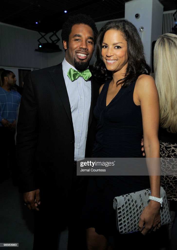 Professional Football Player Dhani Jones and model Veronica Webb pose for a photo at the exclusive viewing party for 'Dhani Tackles The Globe' at Red Bull Space on April 19, 2010 in New York City.