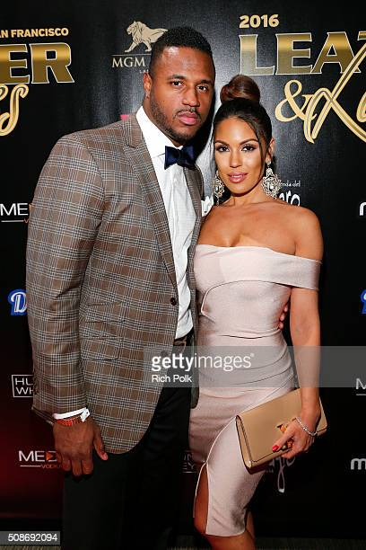 """Professional football player James Anderson and model Carissa Rosario arrive at the 13th annual """"Leather & Laces"""" Mega Party Super Bowl 50 at Metreon..."""
