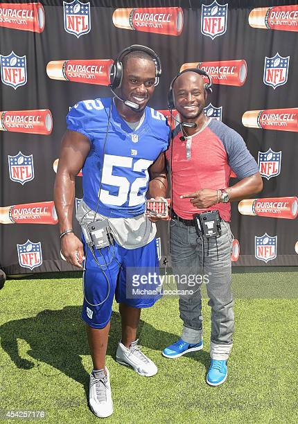 Professional football player Jon Beason and actor Taye Diggs attend an interactive tour of MetLife Stadium on August 27 2014 in East Rutherford New...