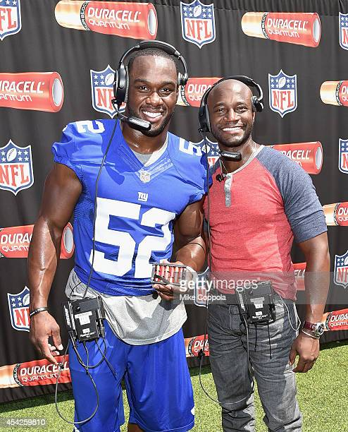 Professional football player Jonathan Beason and actor Taye Diggs attend a Duracell interactive tour of MetLife Stadium on August 27, 2014 in East...