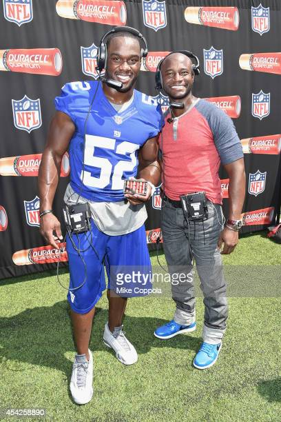 Professional football player Jonathan Beason and actor Taye Diggs attend an interactive tour of MetLife Stadium on August 27, 2014 in East...